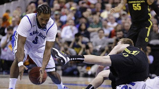 Saint Louis guard Jordair Jett, left, recovers a loose ball during the first half of a third-round game in the NCAA college basketball tournament against Oregon Saturday, March 23, 2013, in San Jose, Calif. (AP Photo/Ben Margot)