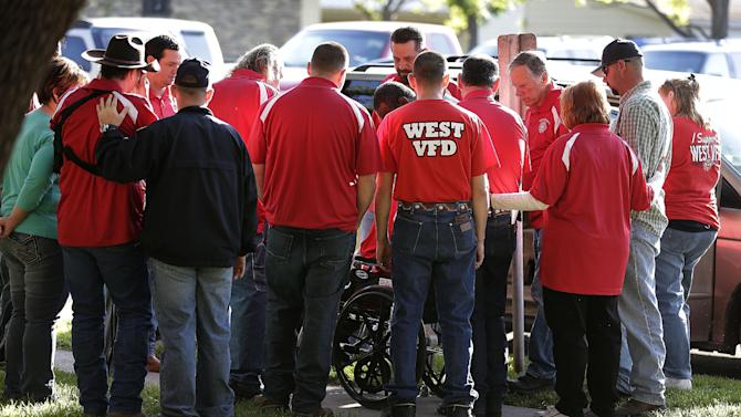 Members of the West Volunteer Fire Department gather after attending a service at St. Mary's Church of the Assumption, Friday, April 19, 2013, two days after an explosion at a fertilizer plant in West, Texas. The massive explosion at the West Fertilizer Co. Wednesday night killed 14 people including numerous members of the West Volunteer Fire Department and injured more than 160. (AP Photo/Charlie Riedel)