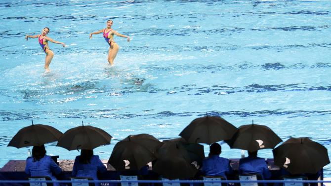 Judges watch team North Korea during the women's synchronised swimming free routine combination final at the Aquatics World Championships in Kazan