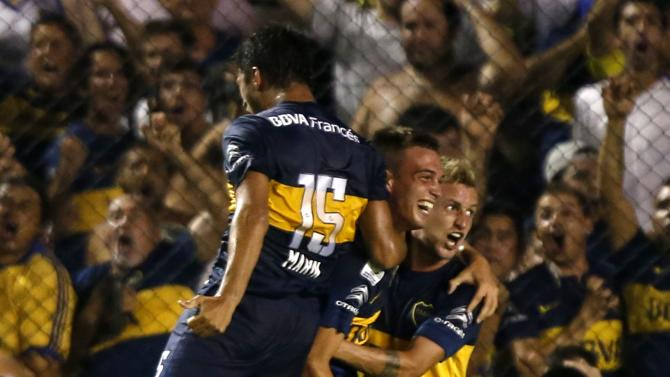 Komar, Marin and Colazo of Argentina's Boca celebrate their team's first goal against Uruguay's Wanderers during their Copa Libertadores soccer match in Buenos Aires