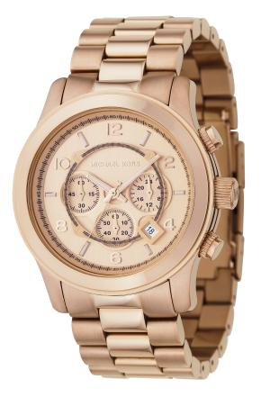 This product image courtesy of Michael Kors shows a Michael Kors rose golden chronograph watch. Holiday buying can send even the most seasoned pro fleeing to her happy place, let alone someone with just a vague notion of what makes a good gift.    (AP Photo/Michael Kors) NO SALES