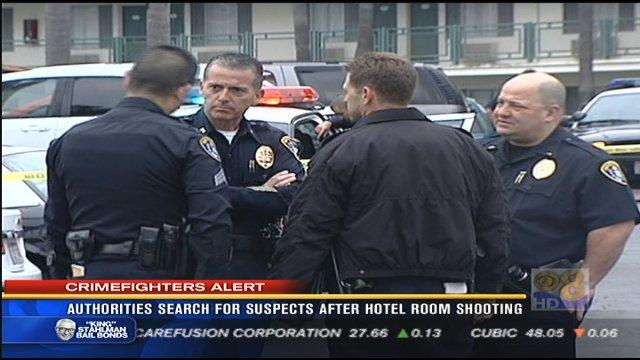 Authorities search for suspects after hotel room shooting