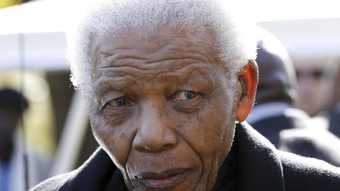 """FILE - In this June 17, 2010 file photo, former South African President, Nelson Mandela  leaves the chapel after attending the funeral of his great-granddaughter Zenani Mandela in Johannesburg, South Africa.  South Africa's presidency says former President Nelson Mandela is suffering from a recurring lung infection and is responding to treatment. The statement Tuesday, Dec. 11, 2012 from presidential spokesman Mac Maharaj said the 94-year-old anti-apartheid icon is """"receiving appropriate treatment and he is responding to the treatment."""" (AP Photo/Siphiwe Sibeko, Pool, File)"""