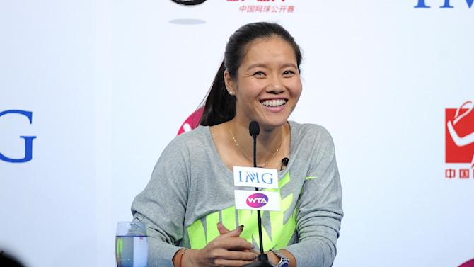 Chinese tennis star Li Na smiles as she answers questions during a press conference, in Beijing, on September 21, 2014