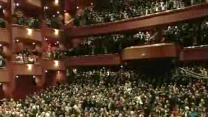 In this image taken from video obtained from Syrian State Television, which has been authenticated based on its contents and other AP reporting, people listen to Syrian President Bashar Assad's speech, not pictured, at the Opera House in central Damascus, Syria, Sunday, Jan. 6, 2013. Syrian President Bashar Assad on Sunday outlined a new peace initiative that includes a national reconciliation conference and a new government and constitution but demanded regional and Western countries stop funding and arming rebels first. (AP Photo/Syrian State Television via AP video)