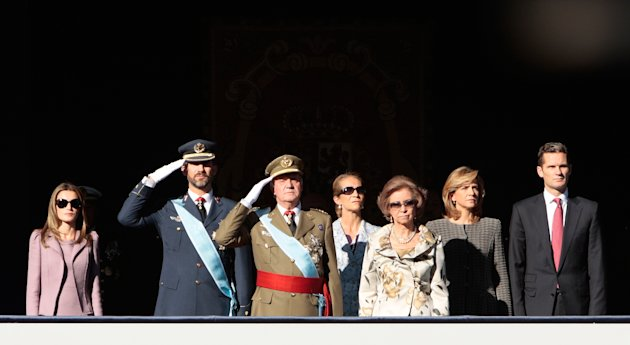 FILE - In this Oct. 12, 2009 file photo, Princess Letizia Ortiz, Spain's Crown Prince Felipe, Spain's King Juan Carlos, Princess Elena, Queen Sofia, Princess Cristina and her husband Inaki Urdangarin, from left, attend a military parade, during the holiday known as Dia de la Hispanidad, Spain's National Day, in Madrid. Spain's Crown Princess Letizia has a penchant for haute couture. Queen Elizabeth II's Bentley's are spotless. Belgium's King Albert II maintains a sumptuous villa in the south of France. But believe it or not, many of Europe's royals are feeling a pinch of the austerity sweeping the continent as it deals with its debt crisis. (AP Photo/Arturo Rodriguez, File)