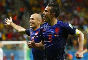 van Persie of the Netherlands celebrates with teammate Robben after scoring the team's fourth goal against Spain during their 2014 World Cup Group B soccer match at the Fonte Nova arena in Salvador