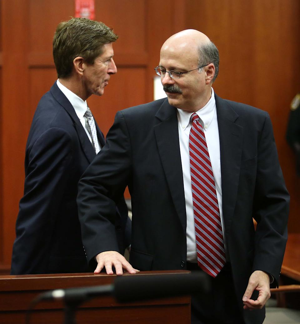 Defense attorney Mark O'Mara, left, and prosecutor Bernie de la Rionda arrive in Seminole circuit court for the George Zimmerman trial in Sanford, Fla., Monday, June 17, 2013. Zimmerman has been charged with second-degree murder for the 2012 shooting death of Trayvon Martin.(AP Photo/Orlando Sentinel, Joe Burbank, Pool)