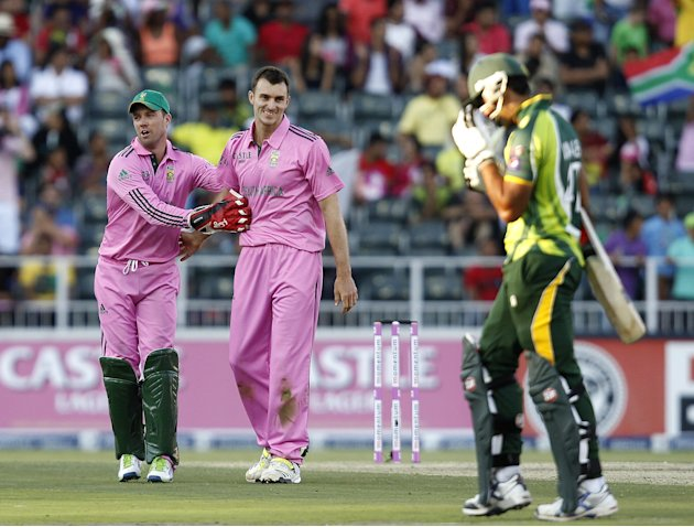 South Africa's McLaren is congratulated by AB de Villiers after bowling out Pakistan's Ajmal during their ODI cricket match in Johannesburg