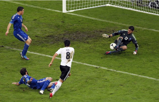 Germany's Oezil misses to score against Greece's goalkeeper Sifakis during their Euro 2012 quarter-final soccer match at the PGE Arena in Gdansk