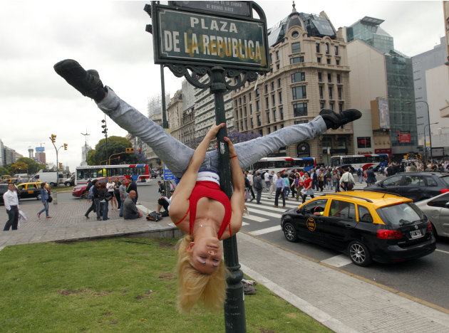 Mara Gonzalez, from Paraguay, performs a pole dancing routine to promote the Miss Pole Dance South America 2012 competition in Buenos Aires