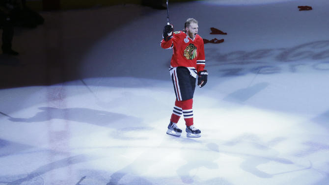 Chicago Blackhawks right wing Patrick Kane (88) acknowledges the crowd as he is named as the number one star of the game after the Blackhawks beat the Boston Bruins 3-1 in Game 5 of the NHL hockey Stanley Cup Finals, Saturday, June 22, 2013, in Chicago. Kane scored two of Chicago's three goals. (AP Photo/Charles Rex Arbogast)