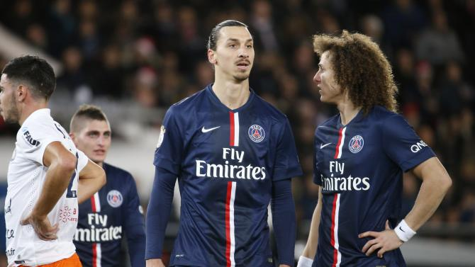 Paris Saint Germain's Ibrahimovic and Luiz react in their French Ligue 1 soccer match against Montpellier at Parc des Princes stadium in Paris