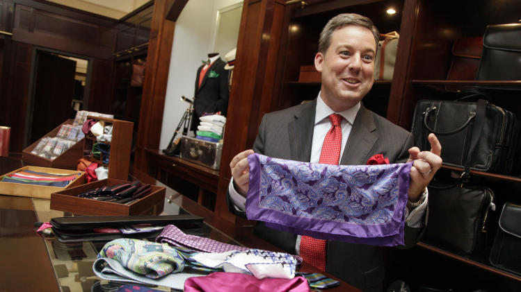 This June 18, 2012 photo shows Ed Henry, chief White House correspondent on the Fox News Channel, talking about his pocket squares and ties at the Brooks Brothers flagship store in New York.  Henry's pocket square flair all started as a friendly fashion competition with a former colleague. It was all about the bigger, better necktie back then, Henry says. There was an unending game of one-upmanship with more colorful shirts, perhaps even a pattered vest. Going around the globe, Henry says he picks up ties and pocket squares as souvenirs, and they act as a bit of a travelogue. (AP Photo/Richard Drew)