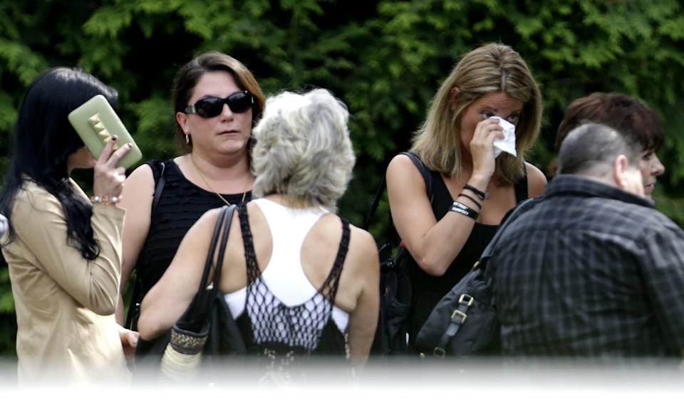 "People arrive at Robert Spearing Funeral Home for a private viewing for actor James Gandolfini, Wednesday, June 26, 2013, in Park Ridge, N.J. Gandolfini, who played Tony Soprano in the HBO show ""The Sopranos"", died while vacationing in Italy last week. (AP Photo/Julio Cortez)"