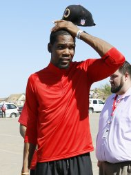 NBA's Oklahoma City Thunder forward Kevin Durant reacts as he looks at the tornado-destroyed Briarwood elementary school in Oklahoma City, Oklahoma May 22, 2013.  Durant's foundation donated $1 million to the American Red Cross for tornado relief. Rescue workers with sniffer dogs picked through the ruins on Wednesday to ensure no survivors remained buried after a deadly tornado left thousands homeless and trying to salvage what was left of their belongings.  REUTERS/Rick Wilking (UNITED STATES - Tags: DISASTER ENVIRONMENT)