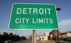 'Detroit City Limits' border sign is seen as traffic enters a westside neighborhood in Detroit