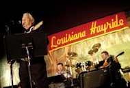 In a Feb. 24, 2008 photo Country musician Claude King performs during a Louisiana Hayride show at the Municipal Auditorium in Shreveport, La. Country singer-songwriter Claude King, an original member of the Louisiana Hayride who was best known for the 1962 hit &quot;Wolverton Mountain,&quot; has died. He was 90. (AP Photo/The Shreveport Times, Val Horvath) MAGS OUT; MANDATORY CREDIT SHREVEPORTTIMES.COM; NO SALES