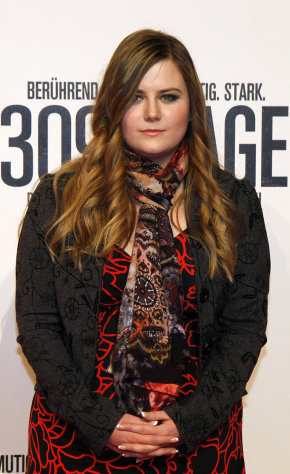 Austrian Natascha Kampusch poses for photographers before the premiere of the film &quot;3096 Days&quot; in Vienna, Austria, Monday Feb. 25, 2013. The film tells the story of Kampusch who was abducted as a schoolgirl and held prisoner in a cellar for almost nine years. (AP Photo/Ronald Zak)