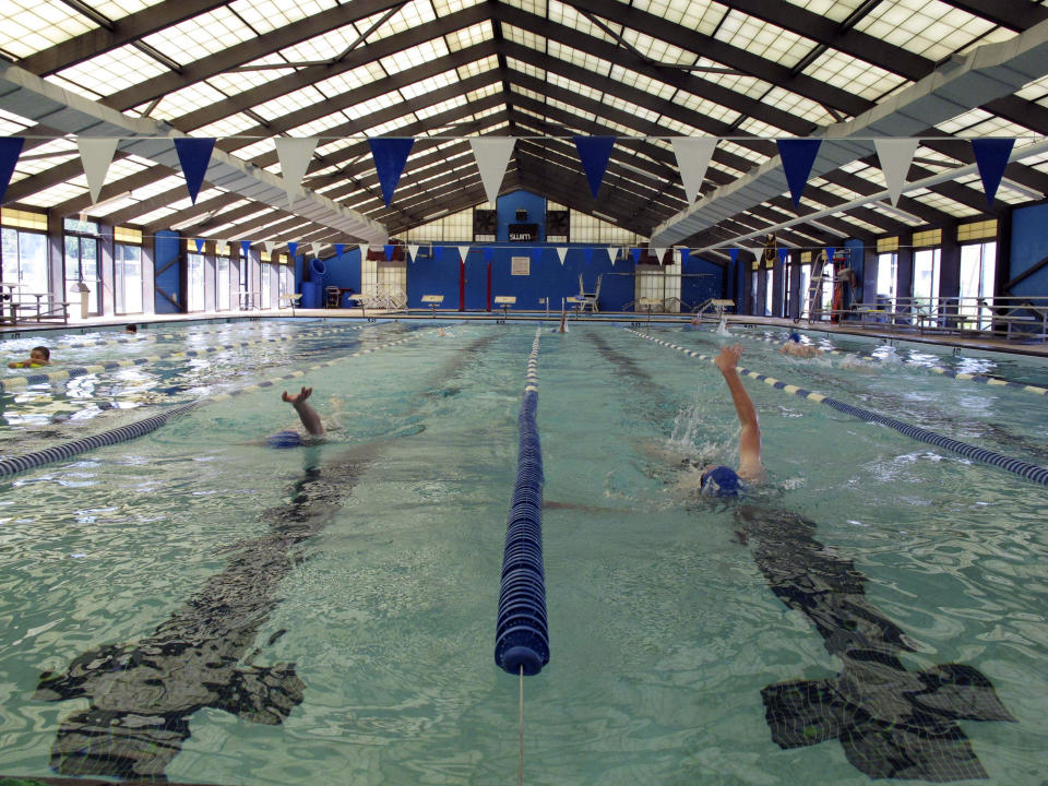 In this May 11, 2011 photo, members of the Anderson Swim Club practice the backstroke at Sheppard Swim Center, in Anderson, S.C. The swim club runs the pool after city officials closed it to the public because they couldn't afford the upkeep. (AP Photo/Jeffrey Collins)