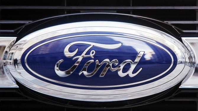 A Ford logo is seen on the grill of a 2015 F-150 truck outside the New York Stock Exchange in New York