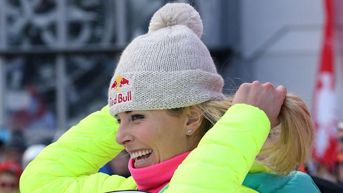 Lindsey Vonn, of United States, smiles after winning an alpine ski women's World Cup downhill in Val d'Isere, France, Saturday, Dec. 20, 2014. (AP Photo/Giovanni Auletta)