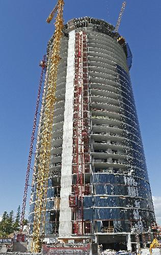 This March 2, 2015 photo shows the under-construction Porsche Design Tower in Sunny Isles Beach, Fla. With a slew of residential and hotel developments, Miami is embracing the notion that homes, like cars, handbags and jewelry, should carry luxe designer labels. (AP Photo/Joel Auerbach)