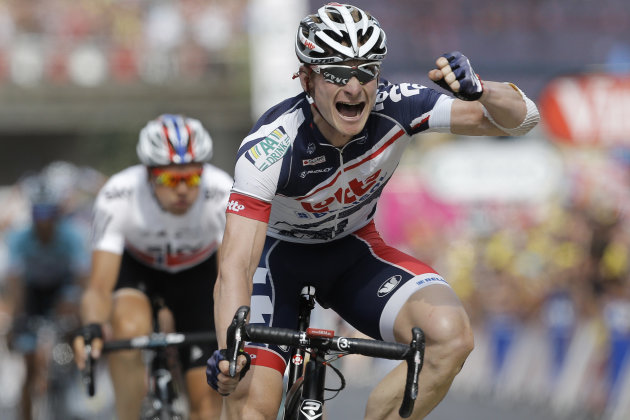 Andre Greipel of Germany crosses the finish line ahead of Edvald Boasson Hagen of Norway, left, to win the 13th stage of the Tour de France cycling race over 217 kilometers (134.8 miles) with start in Saint-Paul-Trois-Chateaux and finish in Le Cap D&#39;Agde, France, Saturday July 14, 2012. (AP Photo/Laurent Cipriani)