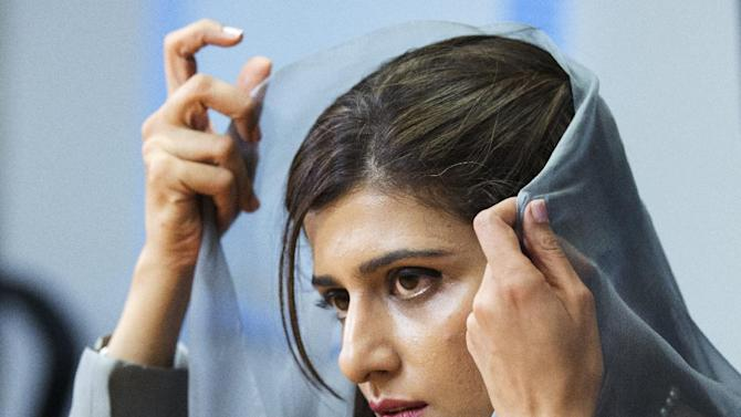 Pakistani Foreign Minister Hina Rabbani Khar, adjusts her veil during an interview with the Associated Press in Washington, Thursday, Sept. 20, 2012.  (AP Photo/Manuel Balce Ceneta)