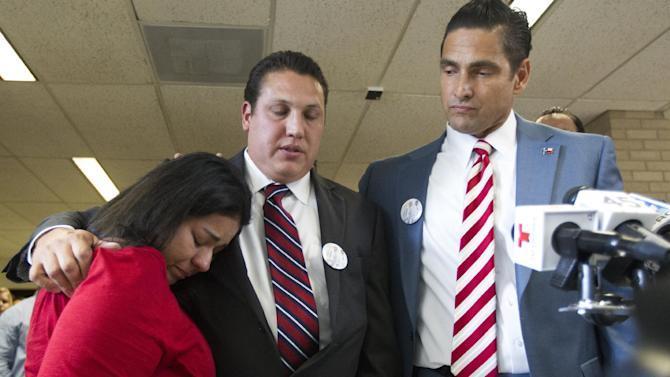 David Barajas stands between his wife Cindy and his attorney Sam Cammack