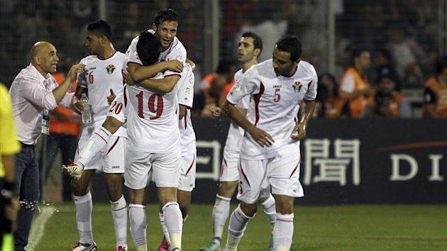 Jordanian players celebrate after a goal against Uzbekistan during their 2014 World Cup qualifying match (Reuters)