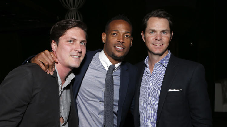 "Open Road's Ben Cotner, Co-Writer Marlon Wayans and Open Roads Film Executive Jason Cassidy attend the premiere of ""A Haunted House"" at the Arclight Hollywood on Thursday, Jan. 3, 2013, in Los Angeles. (Photo by Todd Williamson/Invision/AP)"