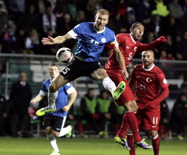 Bulut of Turkey challenges with Klavan of Estonia during their 2014 World Cup qualifying soccer match in Tallinn