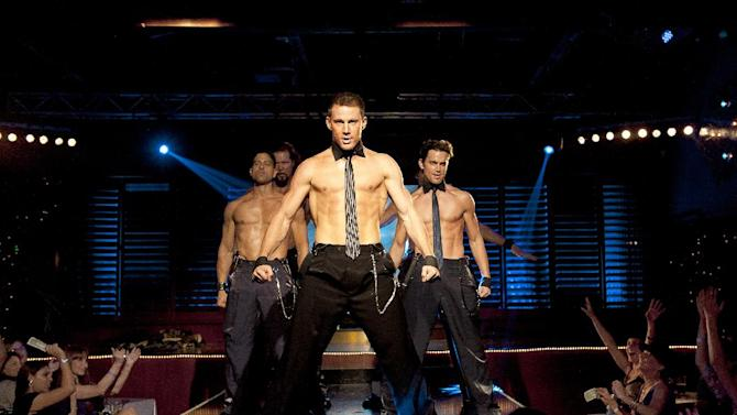 "This film image released by Warner Bros. shows, from left, Adam Rodriguez, Kevin Nash, Channing Tatum, and Matt Bomer in a scene from ""Magic Mike."" Matthew McConaughey, Channing Tatum, Alex Pettyfer, Joe Manganiello and Matt Bomer play fire men, cops and other exaggerated versions of hyper-masculine characters in the Steven Soderbergh film, and they say preparing for their parts and performing nearly nude for the dozens of female extras who populated the fake Club Xquisite gave the actors insight into women's grooming, undergarments and approach to carnal fantasy. (AP Photo/Warner Bros., Claudette Barius)"