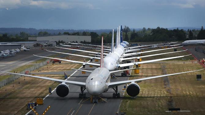 A line of Boeing 787 Dreamliners waiting to be delivered are shown on a closed runway on Tuesday, June 18, 2013 at Paine Field near Boeing's Everett, Wash. assembly plant. (AP Photo/seattlepi.com, Joshua Trujillo)