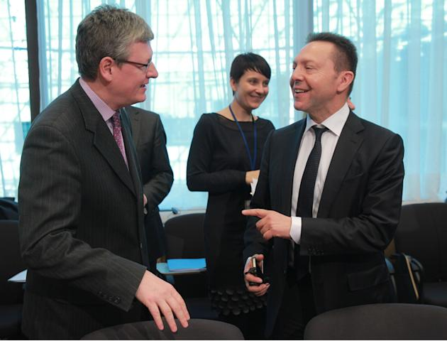 Greek Finance Minister Yannis Stournaras, right, talks with European Commissioner for Employment, Social Affairs and Inclusion Laszlo Andor, during the macro economic dialogue meeting at the European