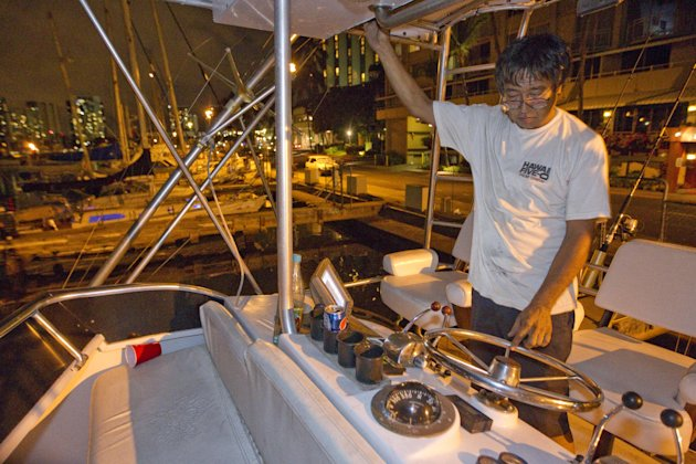 Mike Nakamoto of Honolulu prepare&#39;s his client&#39;s boat moored at the Ala Wai Harbor to take it to deep water after learning of a tsunami warning Saturday, Oct. 27, 2012, in Honolulu. A tsunami warning has been issued for Hawaii after a 7.7-magnitude earthquake rocked an island off the west coast of Canada. The Pacific Tsunami Warning Center originally said there was no threat to the islands, but a warning was issued later Saturday and remains in effect until 7 p.m. Sunday. A small craft advisory is in effect until Sunday morning.(AP Photo/Eugene Tanner)