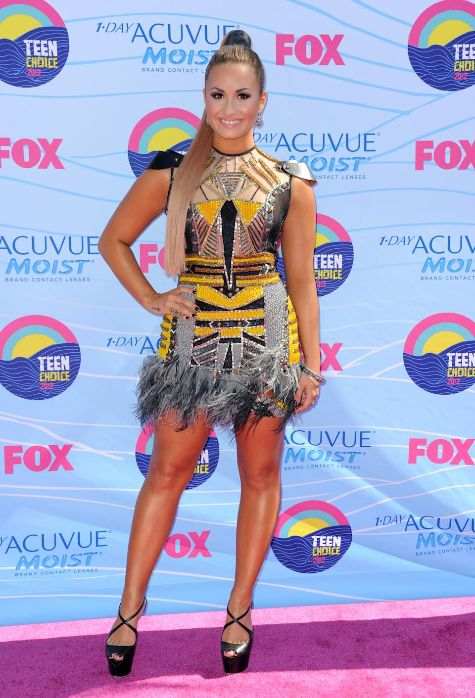 Demi Lovato arrives at the Teen Choice Awards on Sunday, July 22, 2012, in Universal City, Calif. (Photo by Jordan Strauss/Invision/AP)