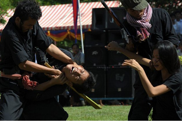 Cambodian students take part in a performance to mark the 'Day of Anger' in Phnom Penh on May 20, 2013