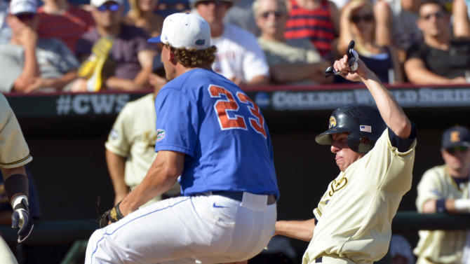 Kent State's Jimmy Rider, right, scores at home plate on a wild pitch against Florida pitcher Jonathon Crawford (23) in the fourth inning of an NCAA College World Series elimination baseball game in Omaha, Neb., Monday, June 18, 2012. (AP Photo/Ted Kirk)