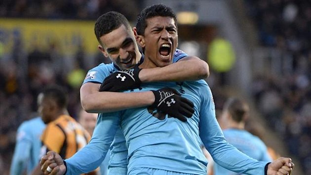 Tottenham Hotspur's Paulinho (R) celebrates scoring with Nabil Bentaleb against Hull City during their English Premier League soccer match at the KC Stadium in Hull, northern England February 1, 2014. REUTERS