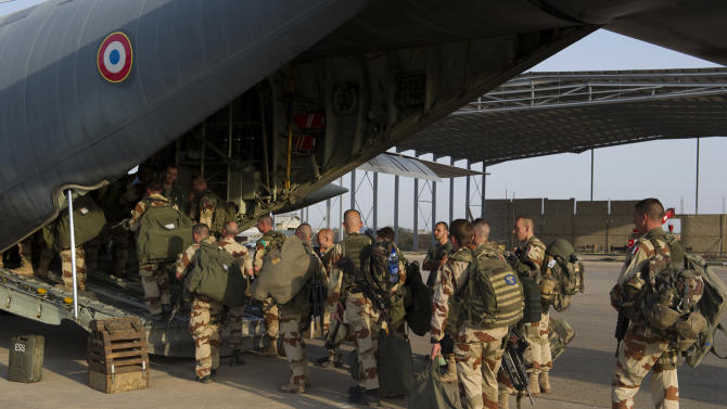 This picture released by the French Army Communications Audiovisual office (ECPAD) shows French soldiers of the 21st Marine Infantry Regiment boarding to Bamako, the capital from Mali, at the N'Djamena's airport, in Chad, Friday, Jan. 11, 2013. The battle to retake Mali's north from the al-Qaida-linked groups controlling it began in earnest Saturday, after hundreds of French forces deployed to the country and began aerial bombardments to drive back the Islamic extremists from a town seized earlier this week. (AP Photo/ R.Nicolas-Nelson, Ecpad)