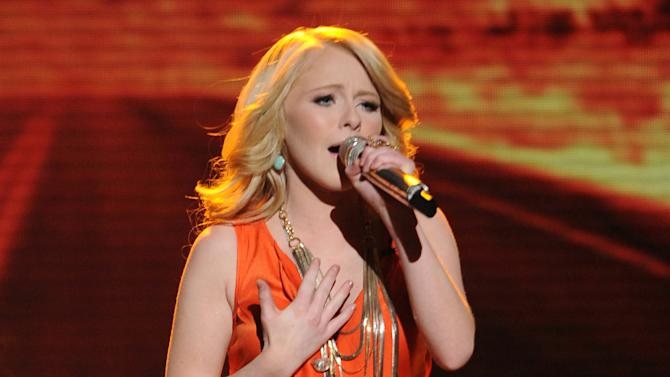 """In this May 9, 2012 photo released by Fox, contestant Hollie Cavanagh performs on the singing competition series """"American Idol,"""" in Los Angeles. (AP Photo/Fox, Michael Becker)"""