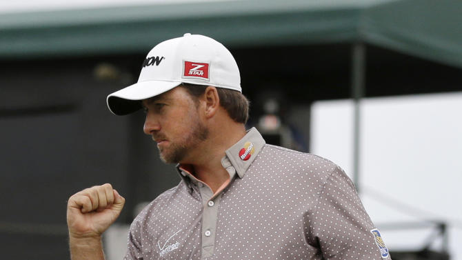 Graeme McDowell, of Northern Ireland, celebrates after making eagle on the 16th hole during the third round of the Cadillac Championship golf tournament, Saturday, March 9, 2013 in Doral, Fla. (AP Photo/Wilfredo Lee)
