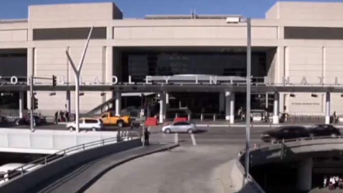 Ground employee arrested in LA airport ice blasts