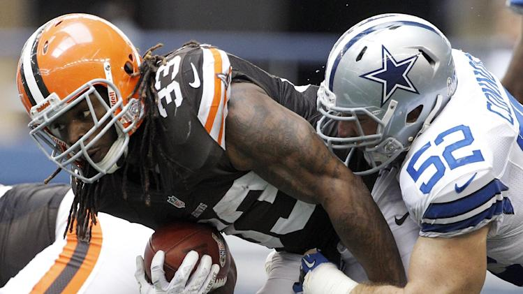 Cleveland Browns' Trent Richardson (33) drags Dallas Cowboys' Dan Connor (52) for extra yards on a run from scrimmage in the second half of an NFL football game, Sunday, Nov. 18, 2012 in Arlington, Texas. (AP Photo/Brandon Wade)