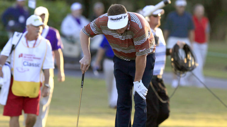 Charlie Beljan bends over due to an illness on the 18th hole during the second round of the Children's Miracle Network Hospitals golf tournament in Lake Buena Vista, Fla., Friday, Nov. 9, 2012. (AP Photo/Julie Fletcher)