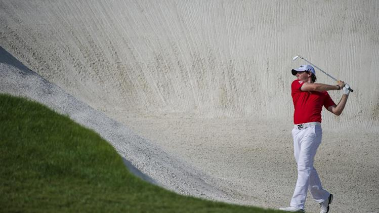 Rory McIlroy of Northern Ireland plays a bunker shot on the 8th hole during the final round of the DP World Golf Championship in Dubai, United Arab Emirates, Sunday, Nov. 25, 2012.  (AP Photo/Stephen Hindley)