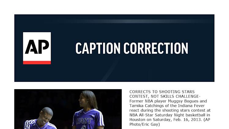 CORRECTS TO SHOOTING STARS CONTEST, NOT SKILLS CHALLENGE- Former NBA player Muggsy Bogues and  Tamika Catchings of the Indiana Fever react during the shooting stars contest at NBA All-Star Saturday Night basketball in Houston on Saturday, Feb. 16, 2013. (AP Photo/Eric Gay)