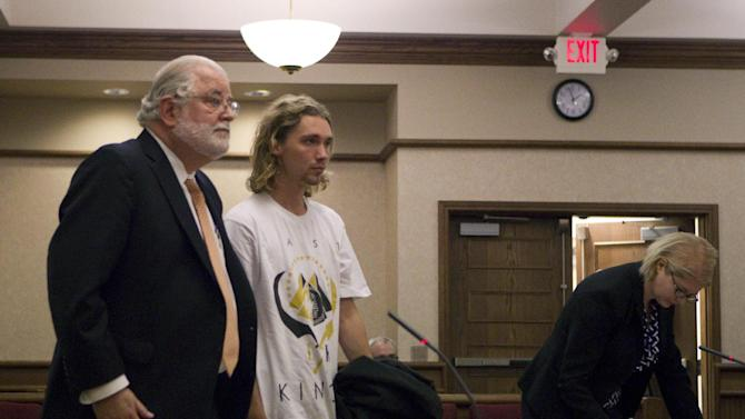 Jesse Helt appears in the Polk County courthouse for an arraignment regarding a probation violation in Dallas, Ore. Tuesday, Sept. 16, 2014.  Helt, the young homeless man who accompanied Miley Cyrus to the 2014 MTV Video Music Awards, arrived 45 minutes late for his arraignment on a charge that he violated his probation in Oregon. Helt didn't enter a plea and he's due back in court next month. (AP Photo/Statesman-Journal, Natalie Behring, Pool)